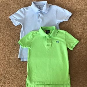 Two golf shirts.  One blue and the other green.